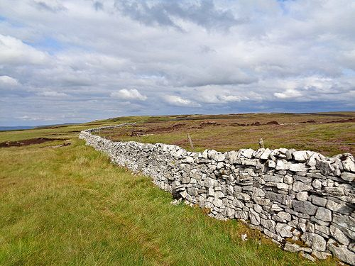 Looking back after the exposed peat area of Birks Fell