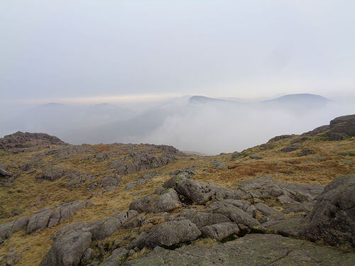 Tops of mountains poking through the mist